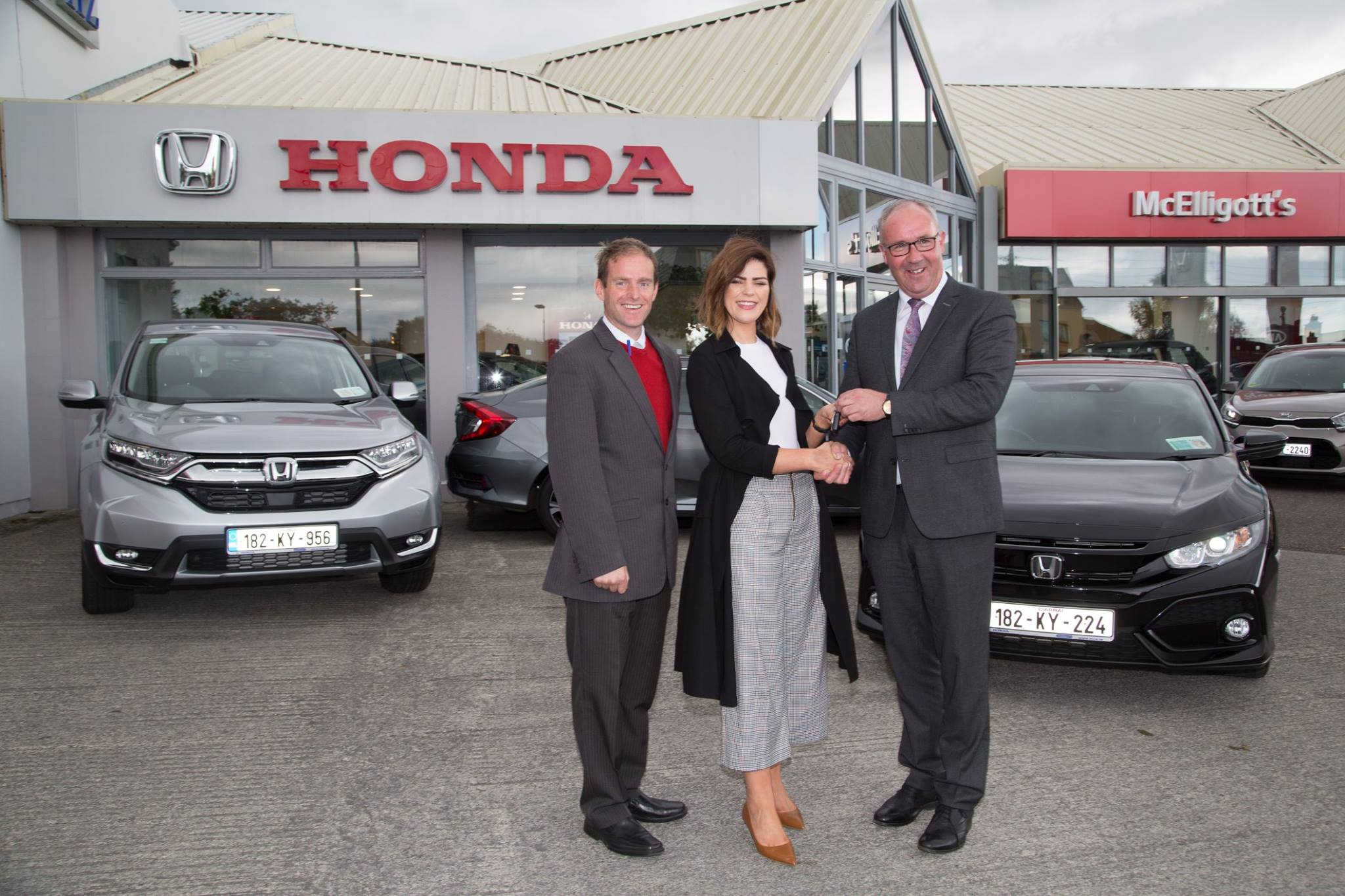 Siobhan Coakley with Martin Mullane and Donal Lynch picking up her Civic