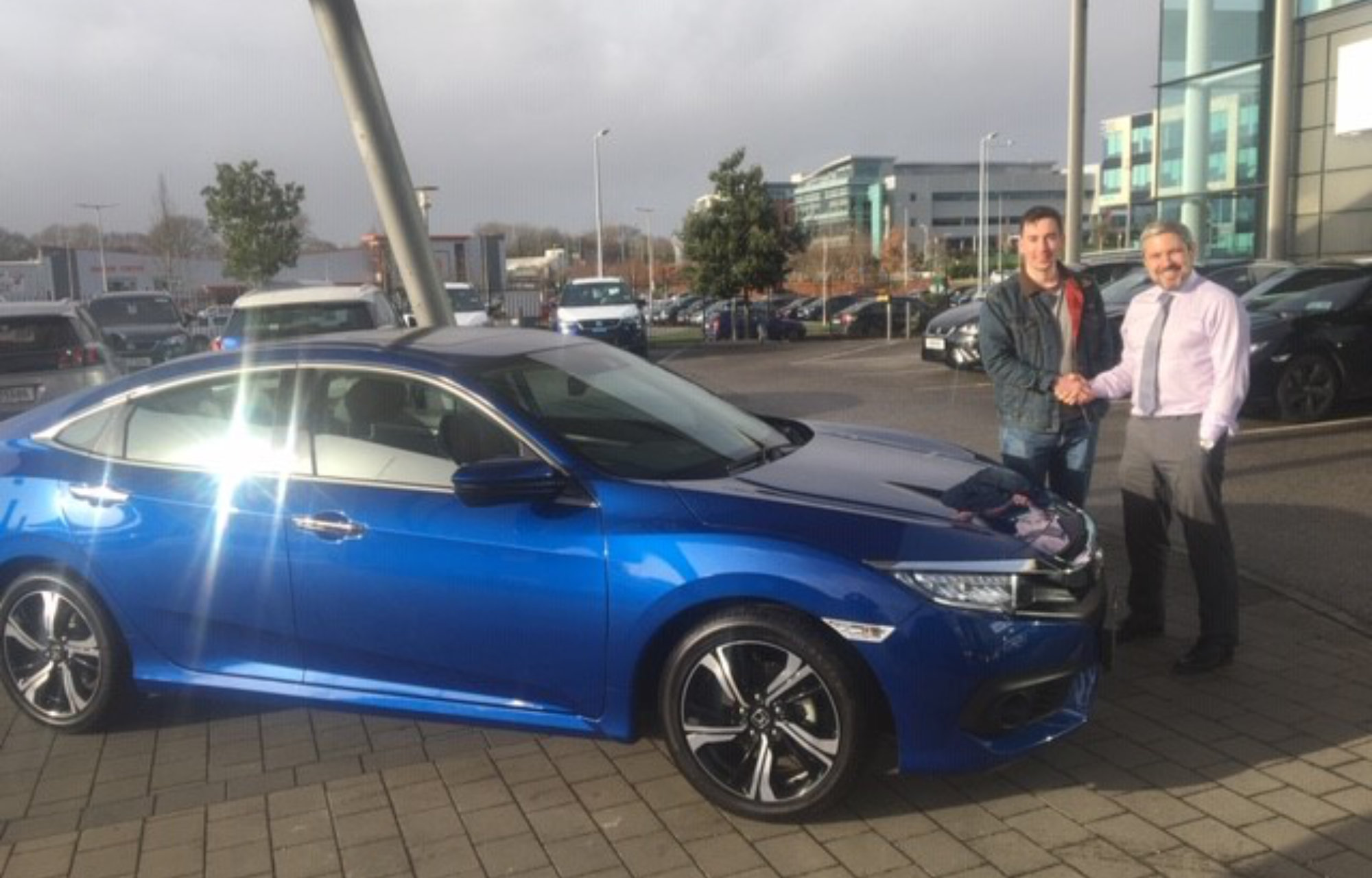 Brendan Keniry collecting his Civic Sedan