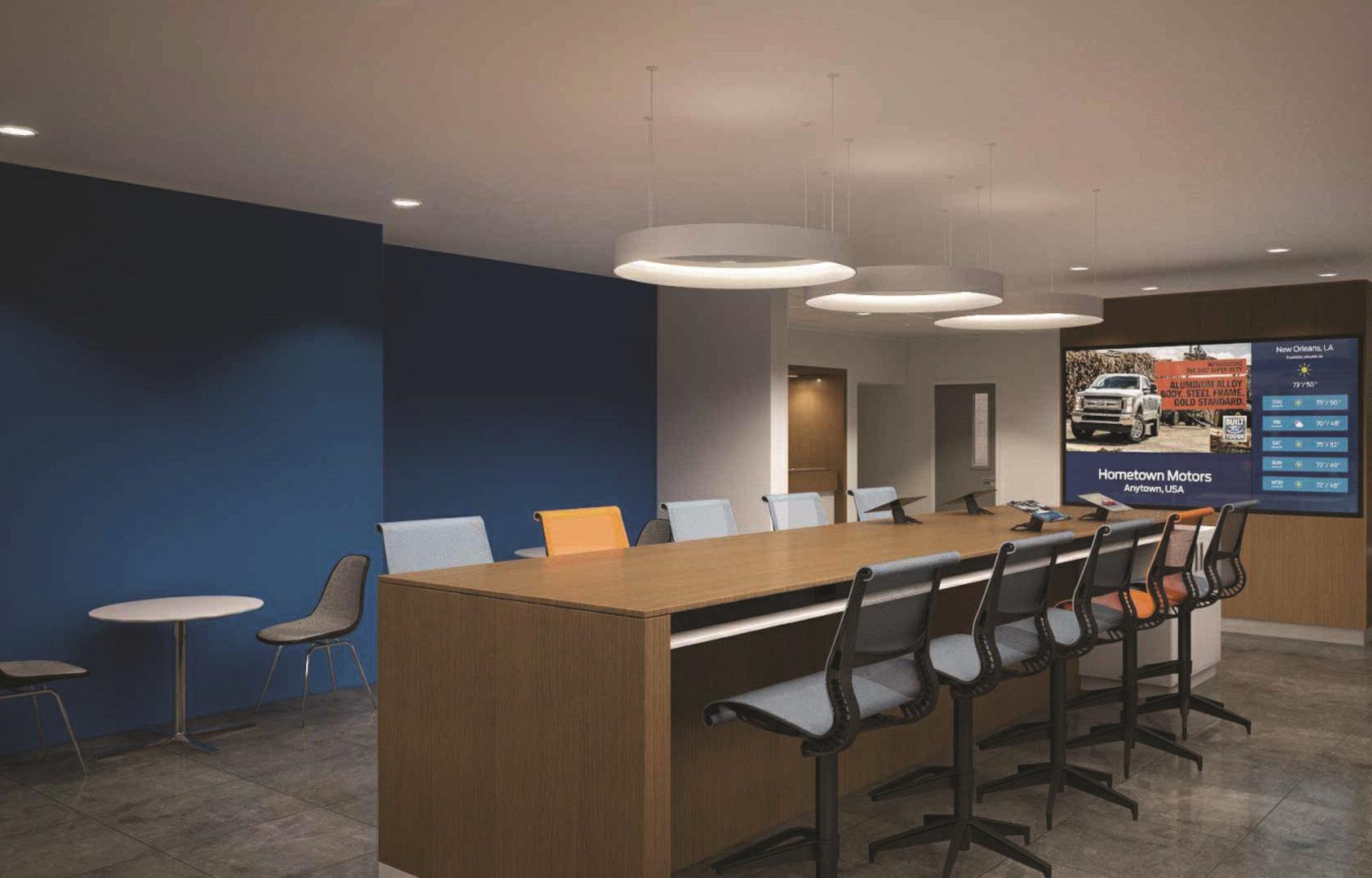 Khu vực trải nghiệm Khách hàng với bàn làm việc lớn cùng màn hình LCD tối tân